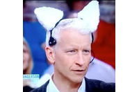 Anderson Cooper wearing a pair of robotic cat ears