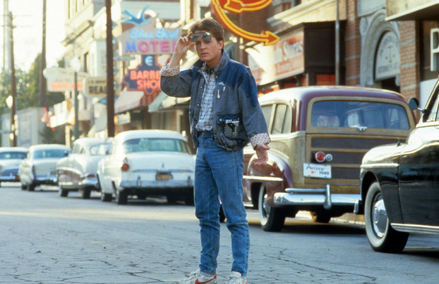 Michael J Fox In 'Back To The Future'Michael J Fox walking across the street in a scene from the film 'Back To The Future', 1985. (Photo by Universal/Getty Images) (C)Getty Images